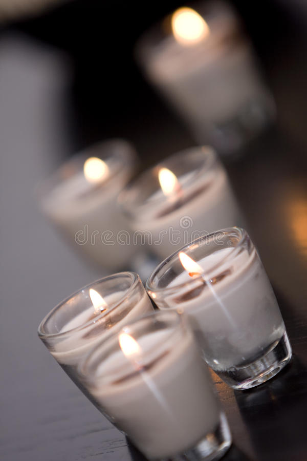 Burning Candles In Glass Holders Stock Photos