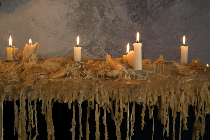 Burning candles on melted wax.many burning candles.Many burning candles. The flames caused by burning are beautiful lines stock images