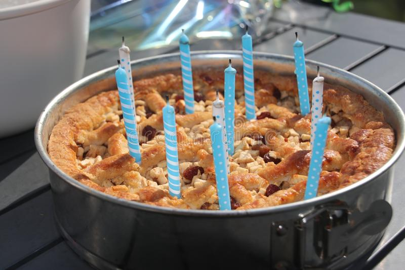 Burning candles number 1 makes 11 in a cake  for a birthday in blue color. royalty free stock photos