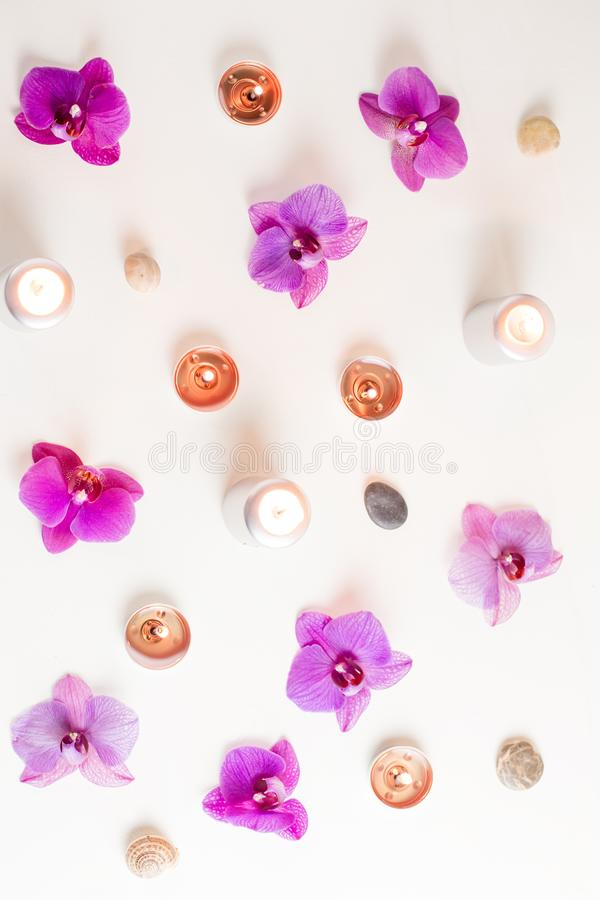 Burning candles and orchid flowers on wooden background. Relaxation spa concept royalty free stock images