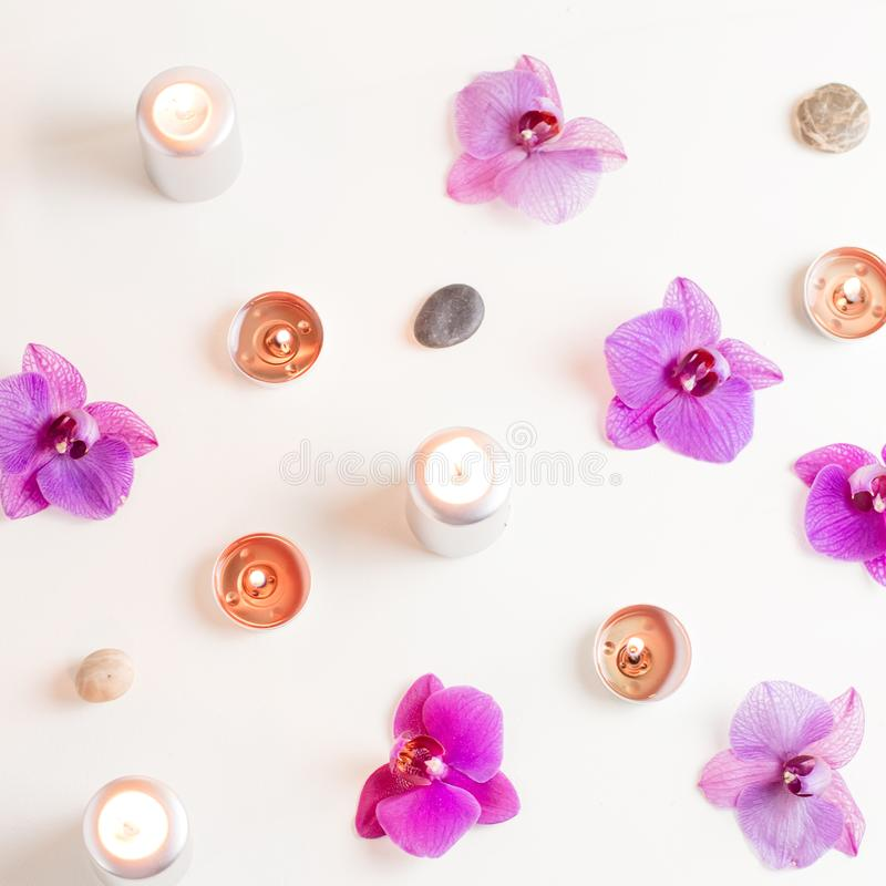 Burning candles and orchid flowers on wooden background. Relaxation spa concept stock photography