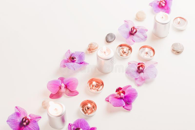 Burning candles and orchid flowers on wooden background. Relaxation spa concept royalty free stock photos