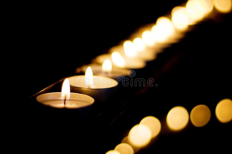 Burning candles. Shallow depth of field. Many christmas candles burning at night. Abstract candles background. Many stock photo