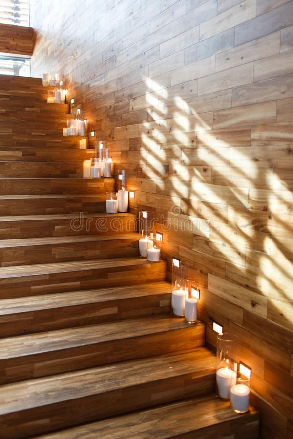 Burning candles on the stairs stock photo
