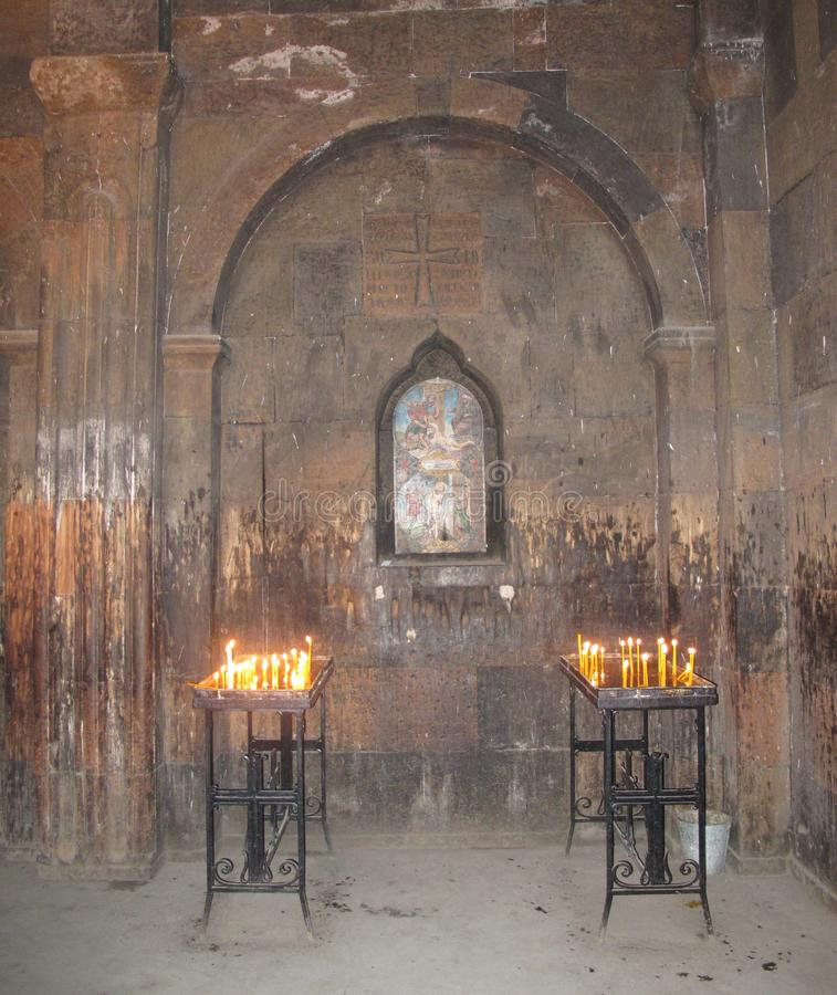 Burning candles in the temple. Is a special act, closely associated with the chants and sacred rites of services royalty free stock photos