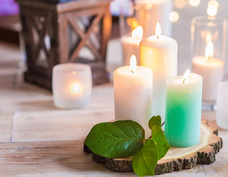 Burning candles in transparent glass vases stock photos