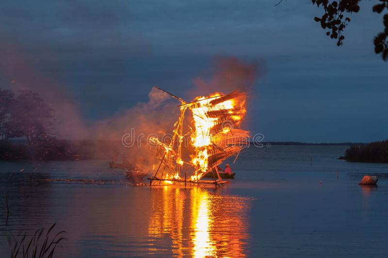 Burning cane sculptures in Baltic Region at pagan festival. Juodkrante town in Lithuania on a Curonian Spit stock photography