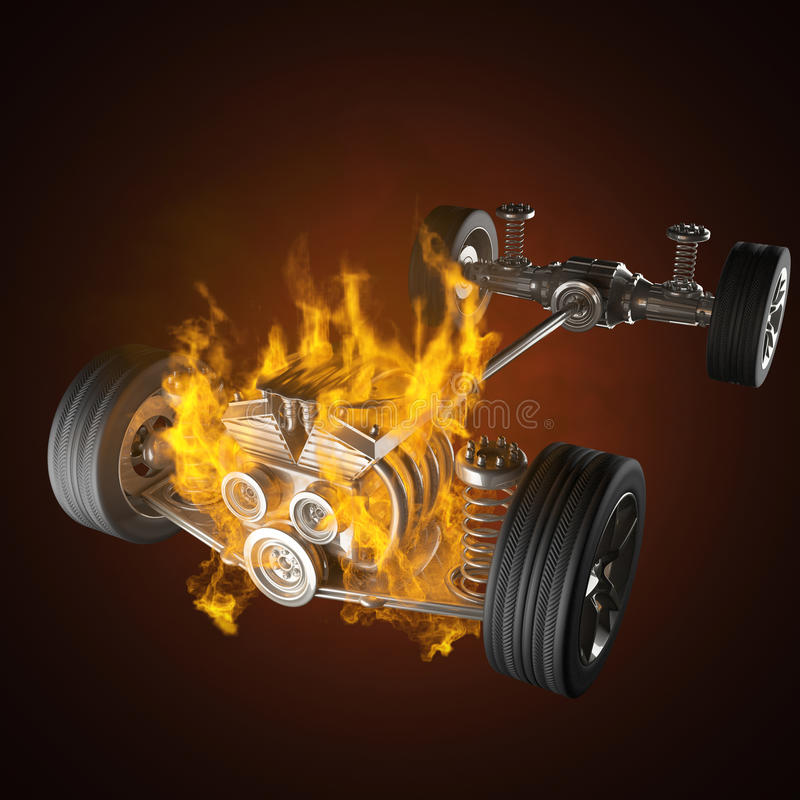 Burning car chassis with engine and wheels stock photography