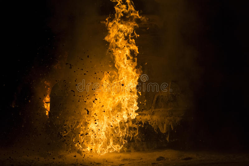 Burning car on the road. In night royalty free stock photos