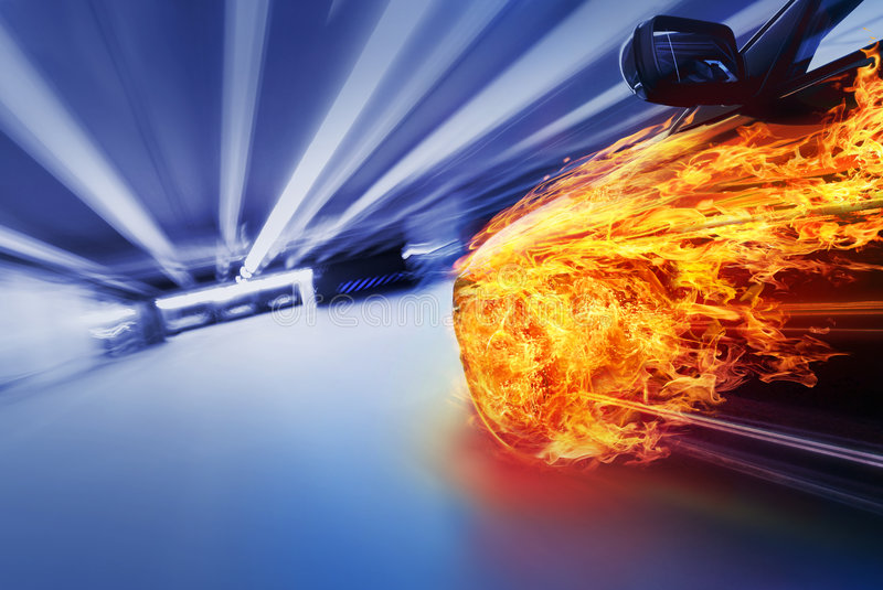 Burning car in tunnel. Fast burning car in tunnel / parking royalty free stock image
