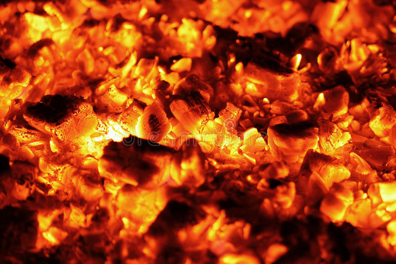 Burning charcoal. Closeup texture of burning charcoal royalty free stock images