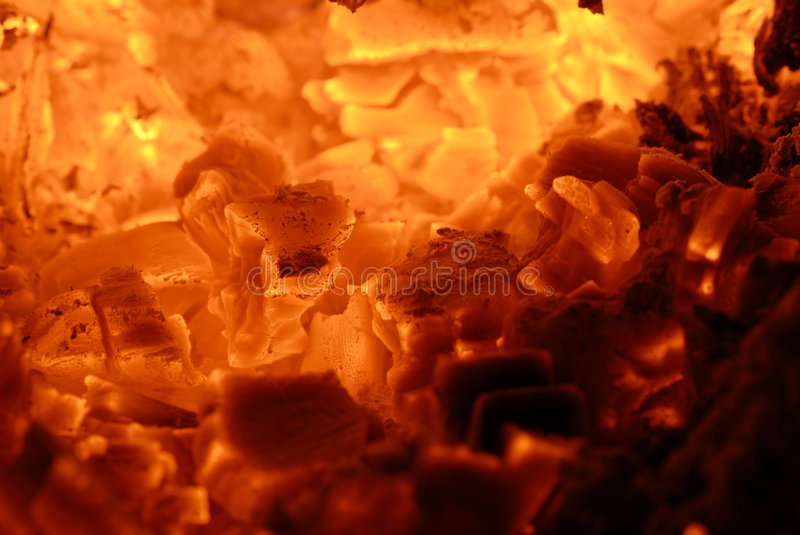 Burning Charcoal. A close up of a burning charcoal stock photo
