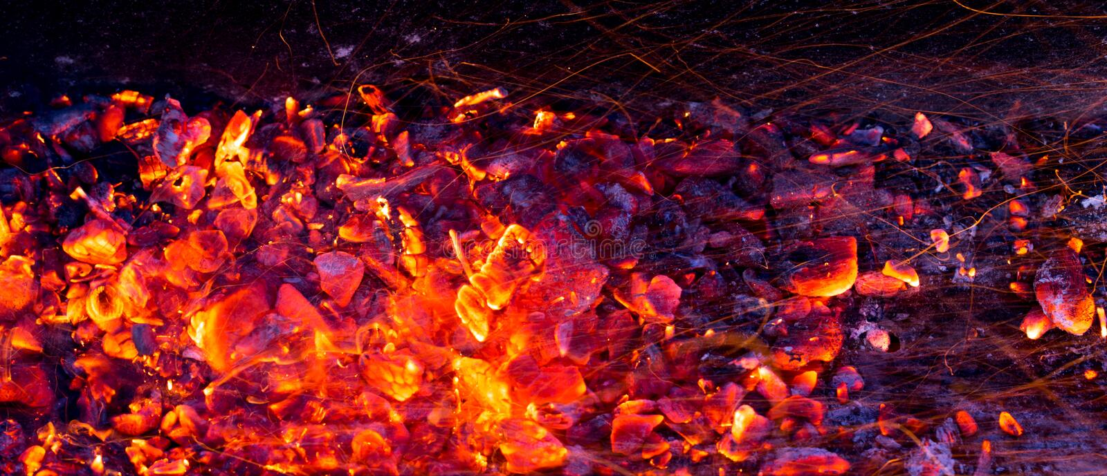Burning charcoal as background stock image