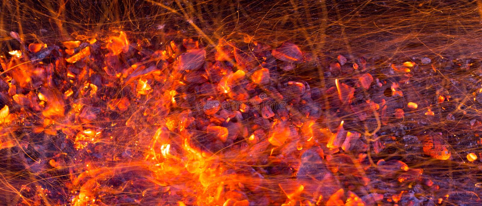 Burning charcoal as background stock photography