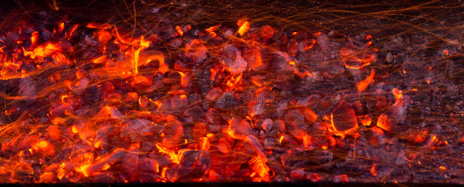 Burning charcoal as background stock photos