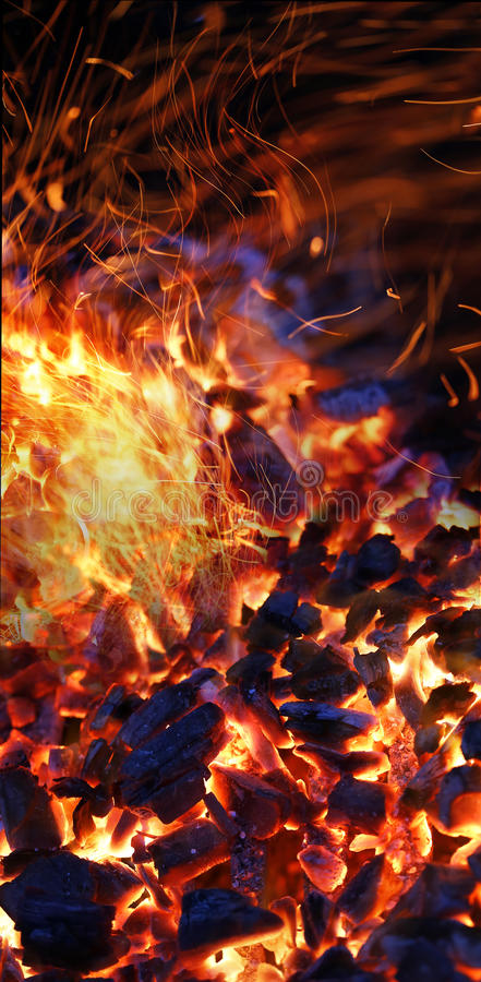 Burning charcoal. Background with fire and sparks royalty free stock photo