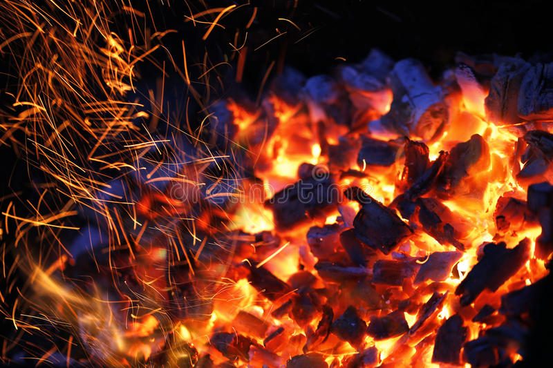 Burning charcoal. Background with fire and sparks royalty free stock photography