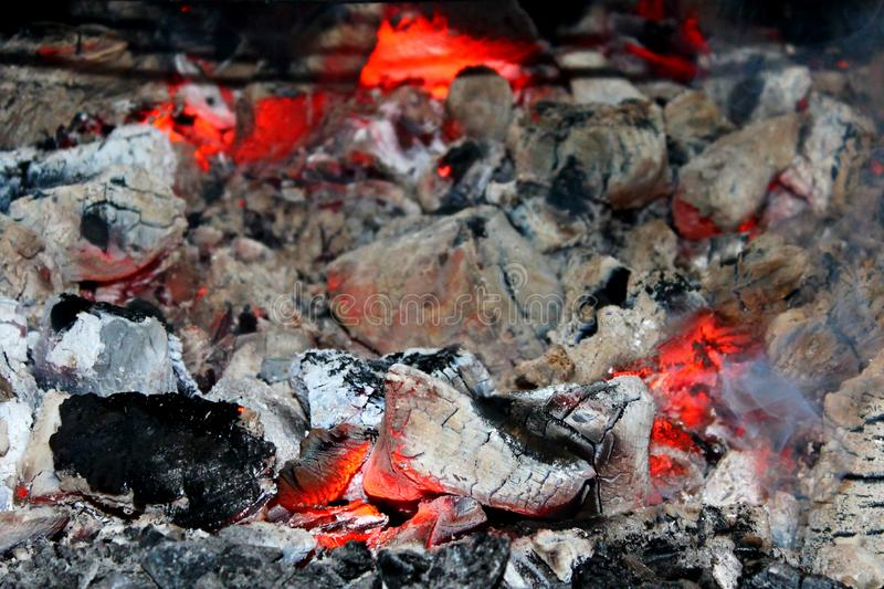 Burning charcoal in a barbecue with smoke royalty free stock photos