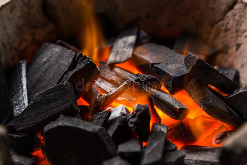 Burning charcoal. Burning black charcoal close up stock image