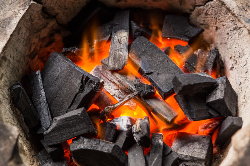 Burning charcoal. Burning black charcoal close-up stock photo
