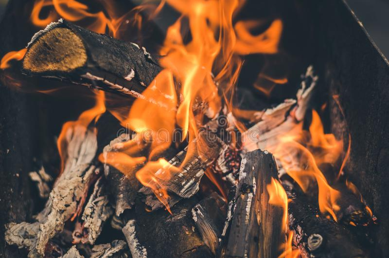 Burning charcoal on charcoal grill/firewood burned in the grill. Fire. burning charcoal on charcoal grill/firewood burned in the grill royalty free stock images