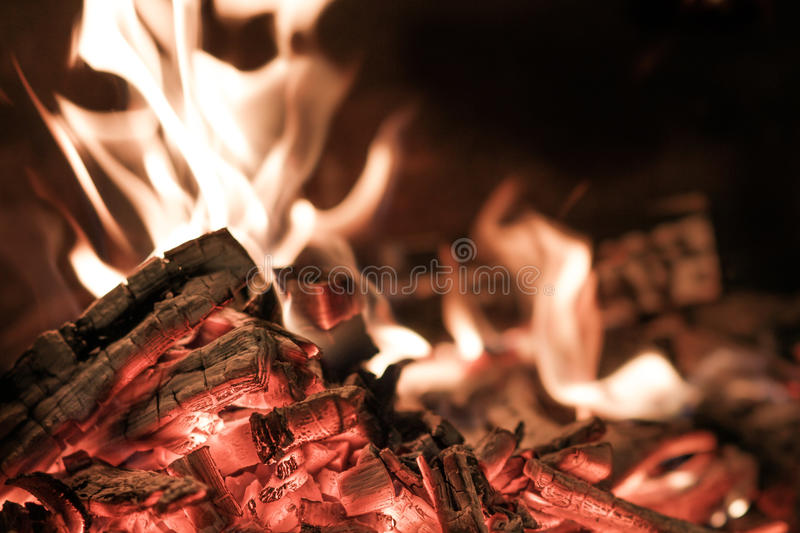 Burning charcoal. Detail of burning charcoal ready for barbecue royalty free stock images
