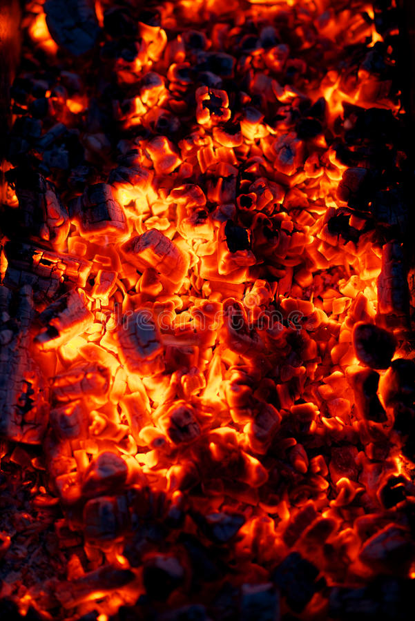 Burning charcoal embers. Background of hot, burning charcoal embers royalty free stock photography