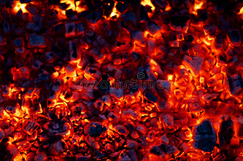Burning charcoal embers. Background of hot, burning charcoal embers stock photo