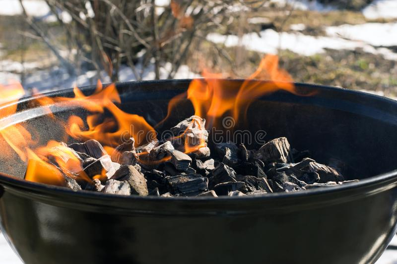 Burning charcoal in an empty ba rbecue grill royalty free stock photography