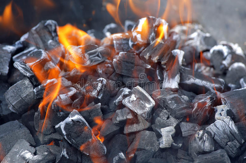 Burning charcoal. Glowing grill fire with burning charcoal stock photography