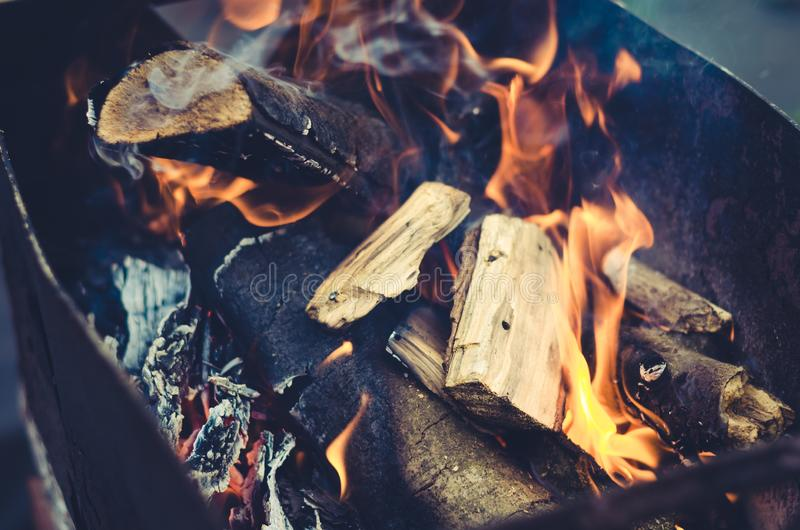 Burning charcoal on charcoal grill/burning firewood in barbecue on the outdoor. Burning charcoal on charcoal grill/ burning firewood in barbecue on the outdoor royalty free stock photography
