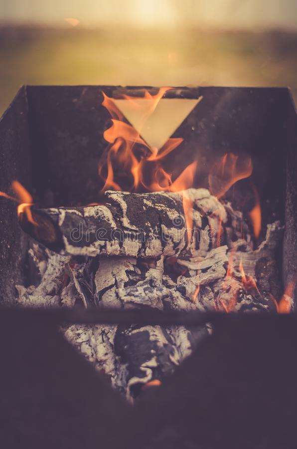 Burning charcoal on charcoal grill/flame of burning coals, toned. Burning charcoal on charcoal grill/ flame of burning coals, toned royalty free stock image