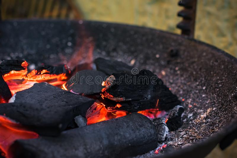 Burning charcoal grill. Picnic, grilling food. Closeup royalty free stock image