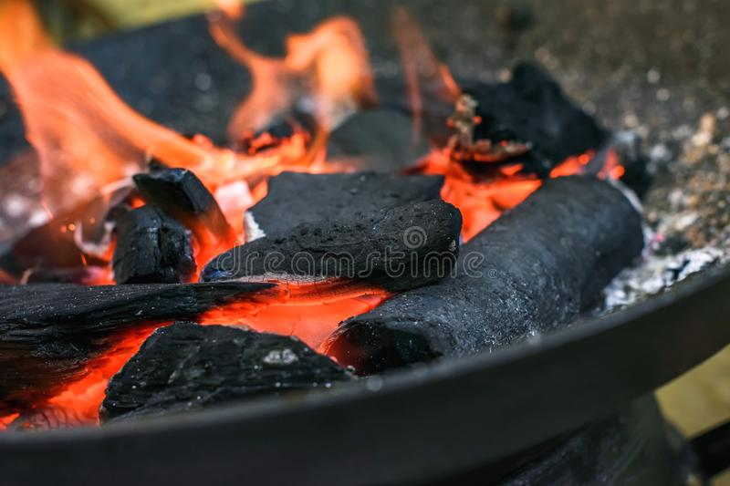 Burning charcoal grill. Burning charcoal ready to cook grilled food stock images