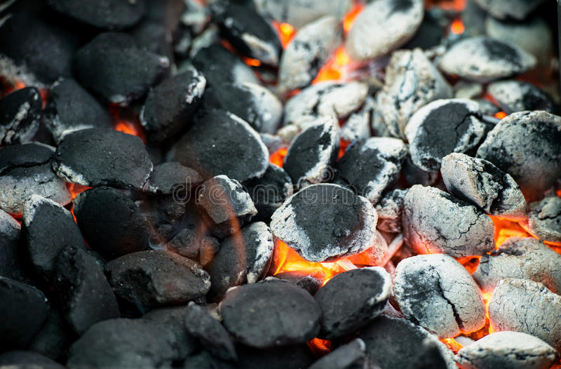 Burning charcoal. Made ​​from birch in pellet form royalty free stock photography