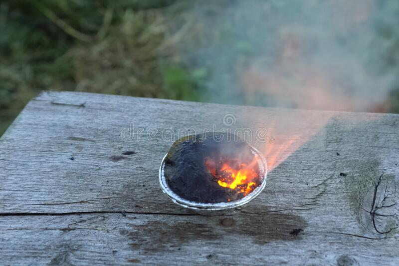Burning chemical in the cup royalty free stock image