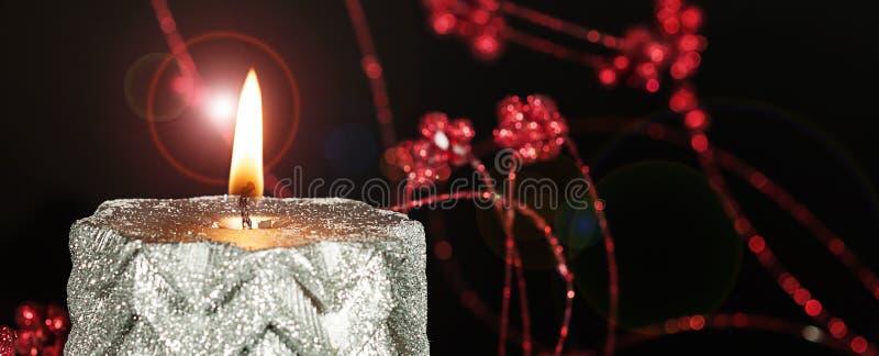 Burning Christmas Candle Flame royalty free stock photos
