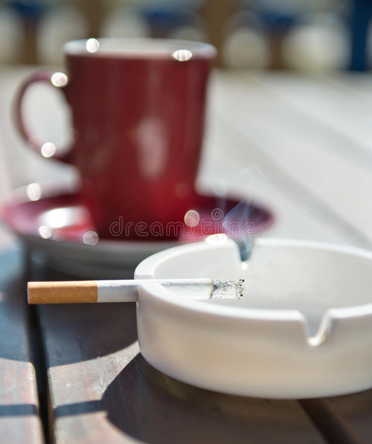 Free Burning Cigarette In The Ashtray Royalty Free Stock Photo - 26959725
