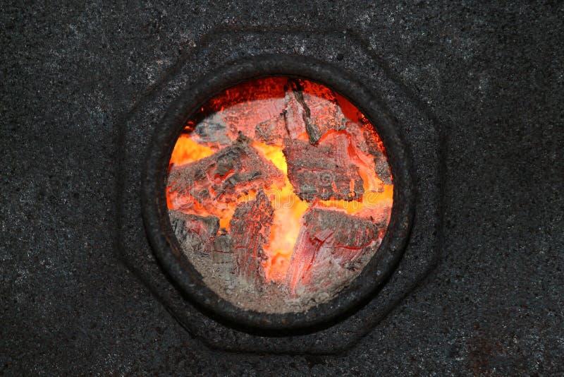 Burning coal hole stock photos