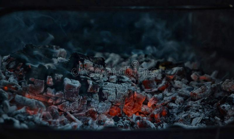 Burning coal in iron brazie stock images