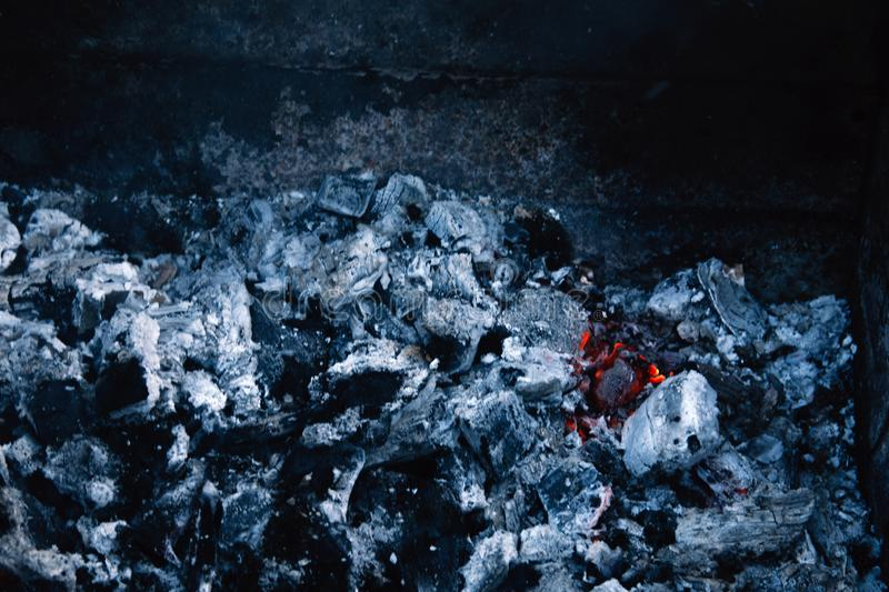 Burning coal, soft focus. Textures, background, abstract. Embers stock photo