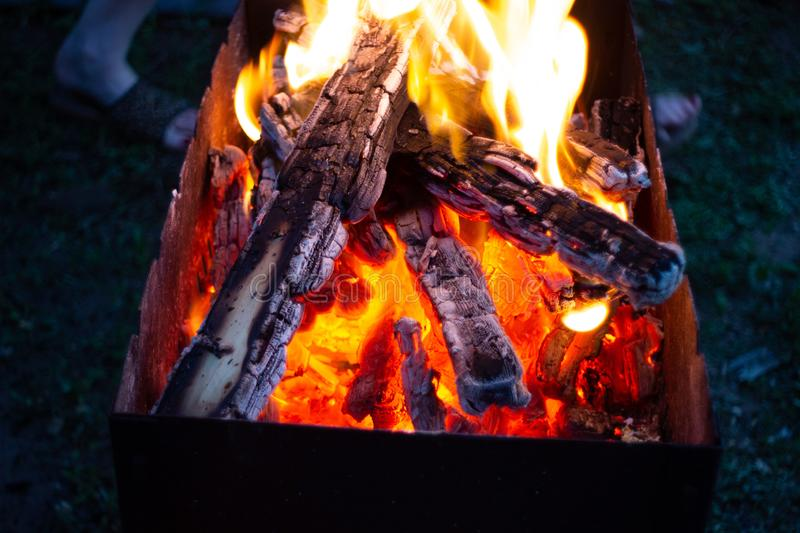 Burning coals in the fireplase stock photography