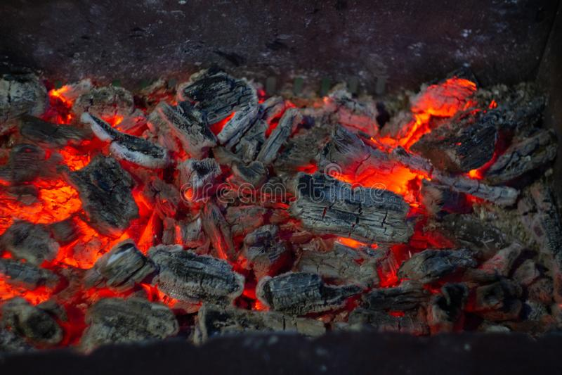 Burning coals in the fireplase royalty free stock photography