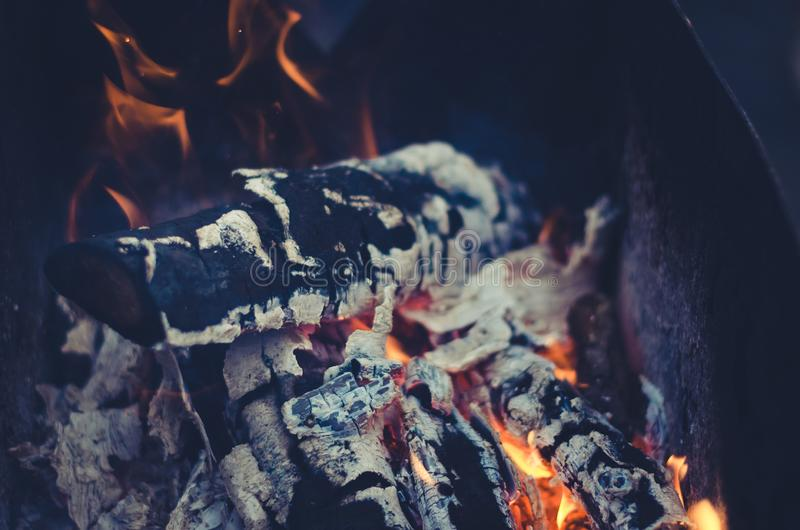 Burning coals on the grill/burning charcoal on charcoal grill. Fire. burning coals on the grill/burning charcoal on charcoal grill stock photo