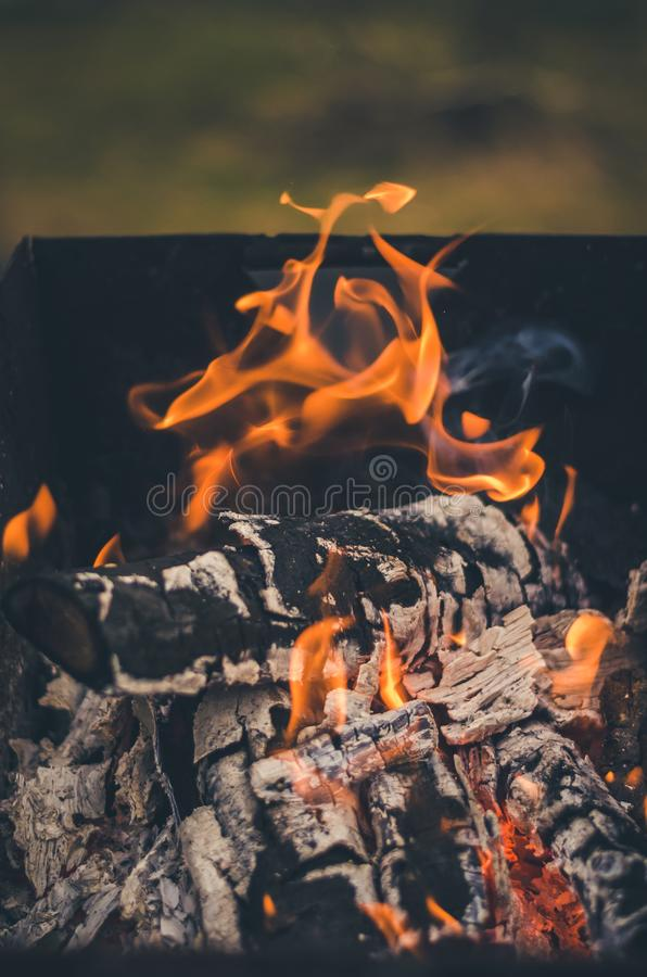 Burning coals on the grilll/burning charcoal on charcoal grill on the outdoor. Burning coals on the grilll/ burning charcoal on charcoal grill on the outdoor stock photography