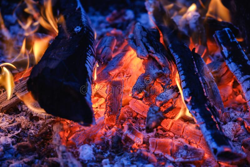 Burning coals at night ,Decaying charcoal, barbeque. Season royalty free stock photo