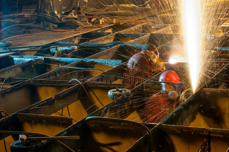Burning deck of a ship. Replacing the main deck of the ship by the Gdansk shipyard workers Repair Polish royalty free stock photo