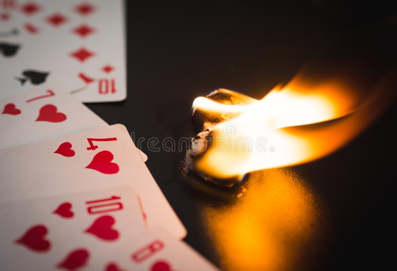 Burning dice with playing cards abstract stock photography