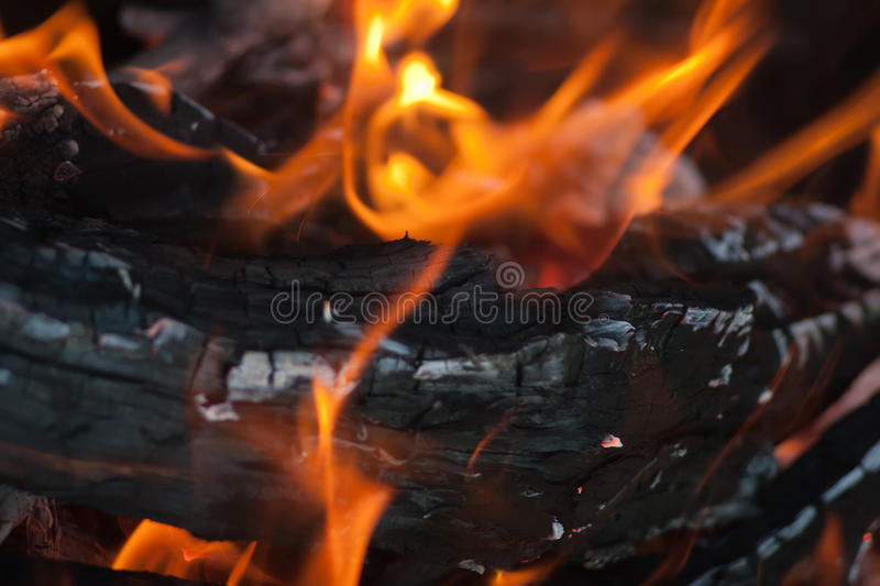 Burning Fire. Logs burning close in a fireplace background royalty free stock photos