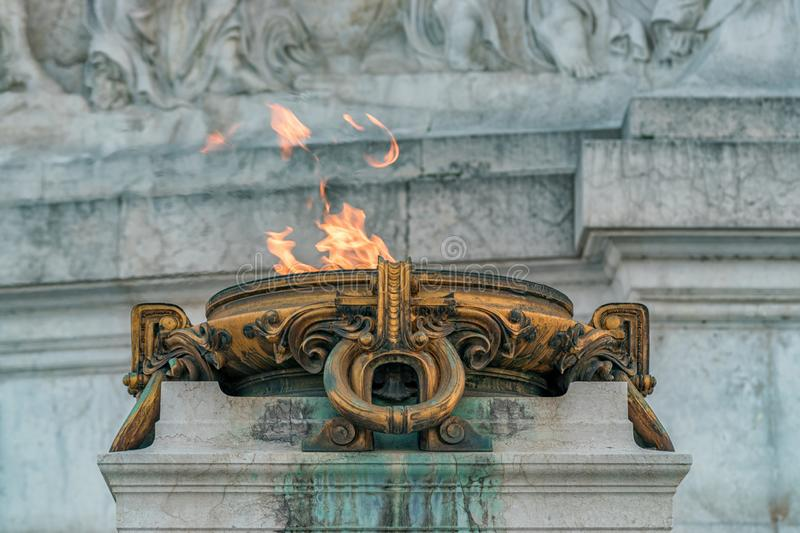 The burning fire altar in front of ancient Building in Rome City, Italy.  stock photos